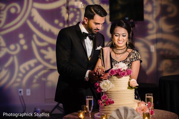 Sweet Indian couple cutting cake scene.