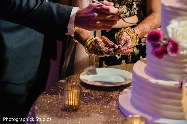 Closeup capture of cutting cake scene.