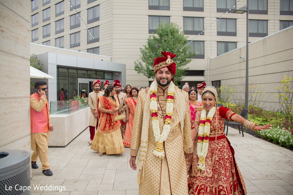 Indian groom and bride looking happy