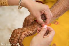 Maharani getting a bracelet at haldi.