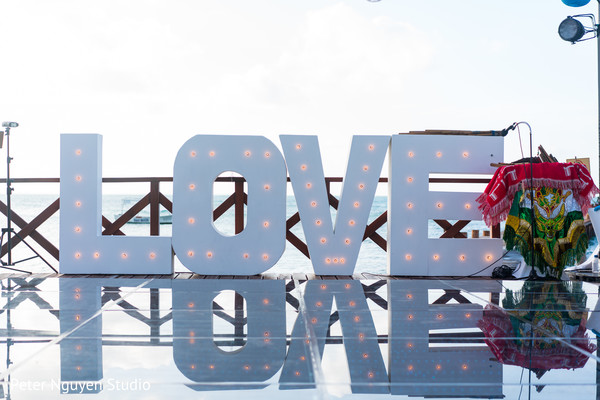 Incredible Indian sangeet love sign decor.
