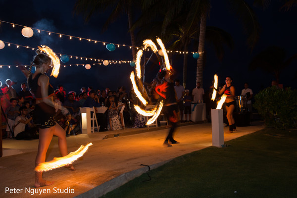 Fire dancers at sangeet party.