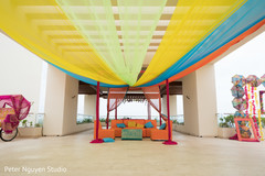 Colorful Indian pre-wedding draping decorations.