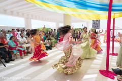 Indian bride dancing at her Haldi party.