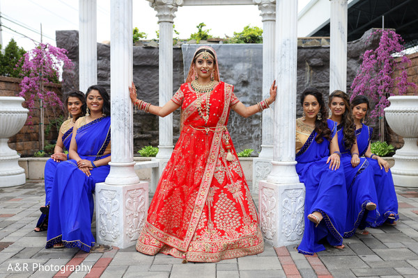 Indian bride posing with the Maharanis