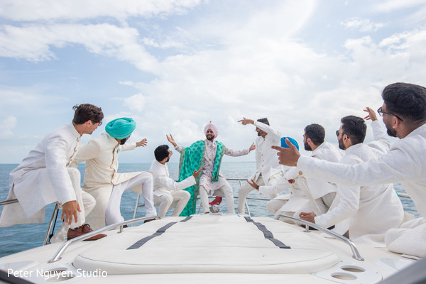 Indian groom having fun with groomsmen.