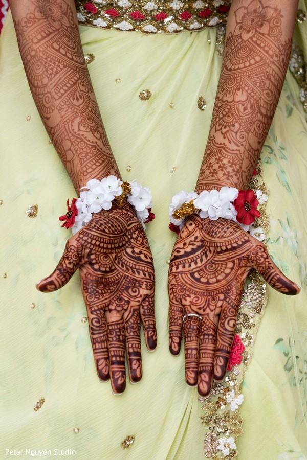 Maharani showing her henna art on her hands.