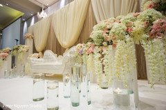 Incredible Indian wedding reception stage flowers.