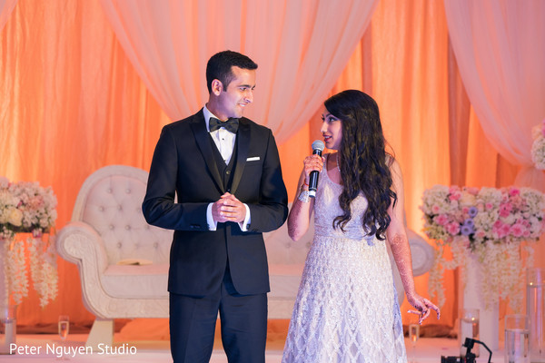 Indian bride and grooms capture during  speech.