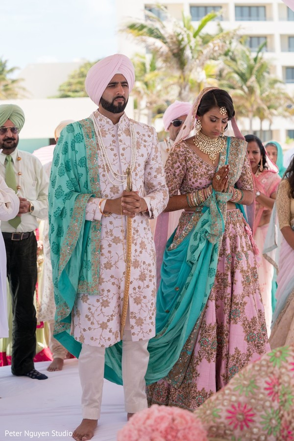 Indian lovebirds at wedding ceremony capture.