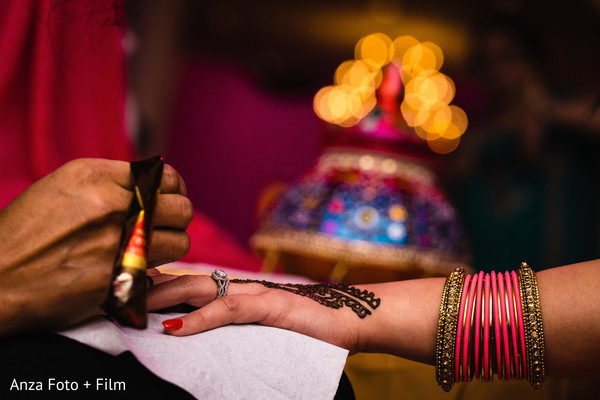 Indian bride getting her mehndi ar done.