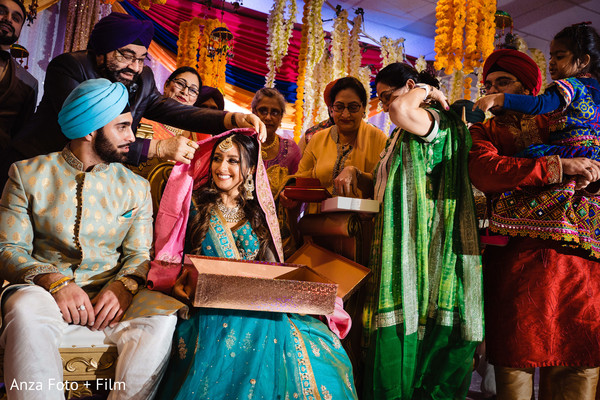 Indian bride getting a ghoonghat on.