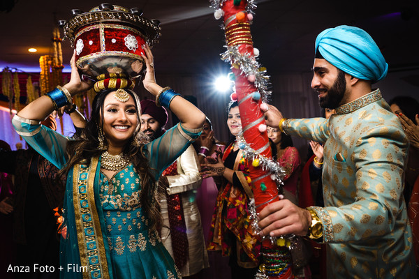 Indian couple dancing at their pre-wedding celebration.