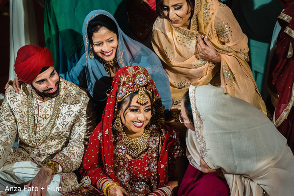 Indian couple sharing with relatives.