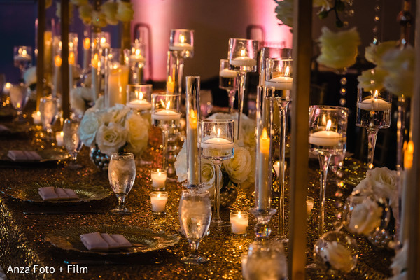 Indian wedding reception candles decor.