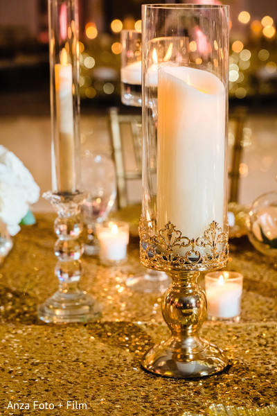Indian wedding reception table candle decoration.