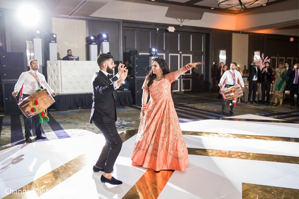 Maharani and Indian groom dancing