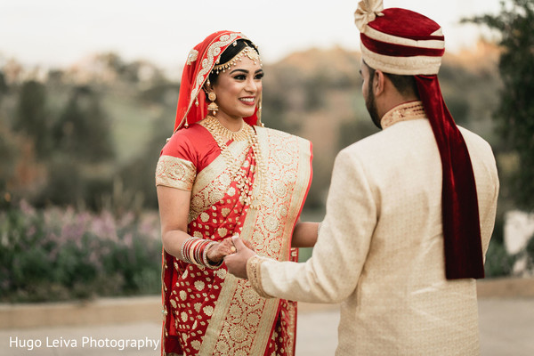 Indian bride and groom outdoors meeting