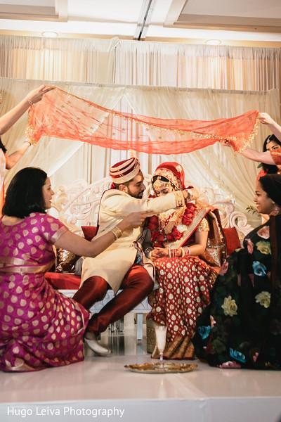 Groom putting the garland on the Maharani