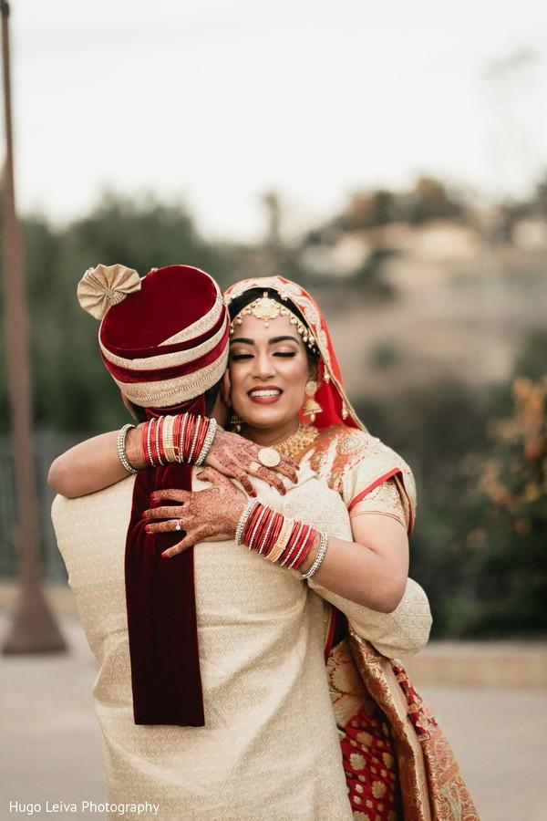 Indian bride hugging the Raja