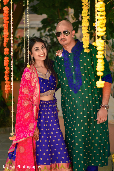 Lovely Indian couple posing on their pre-wedding outfits.