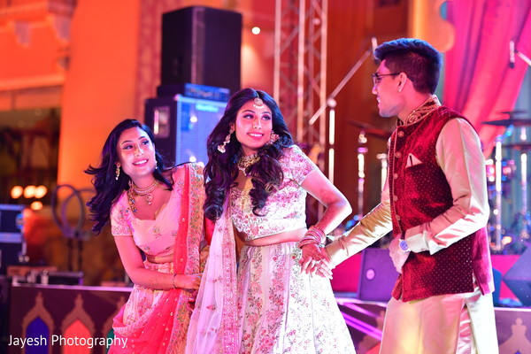 Enchanting Indian bride at a sangeet performance.