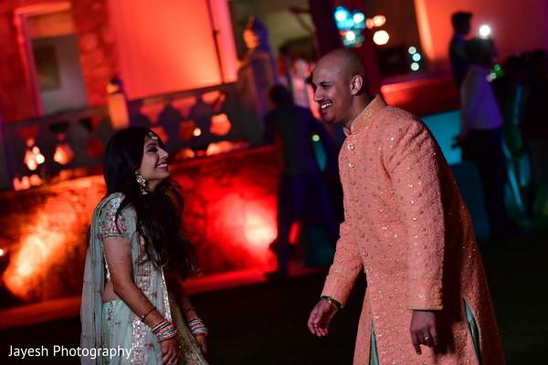 Lovely Indian couple at sangeet celebration.