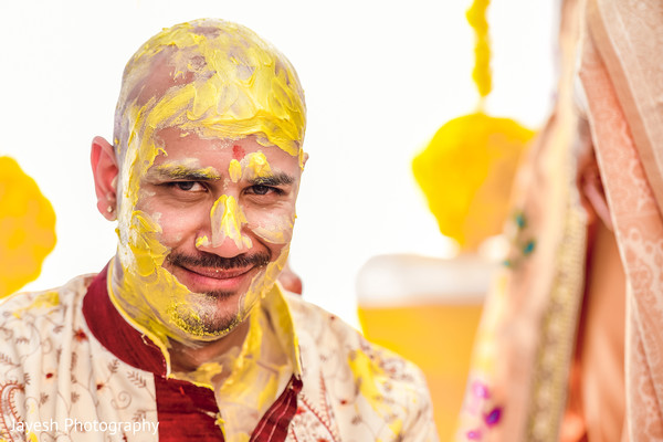 Take a look at this Indian groom with turmeric paste on.