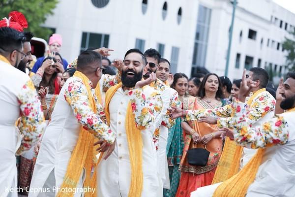 Indian groomsmen dancing.