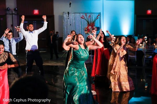 Cheerful Indian wedding reception choreography.