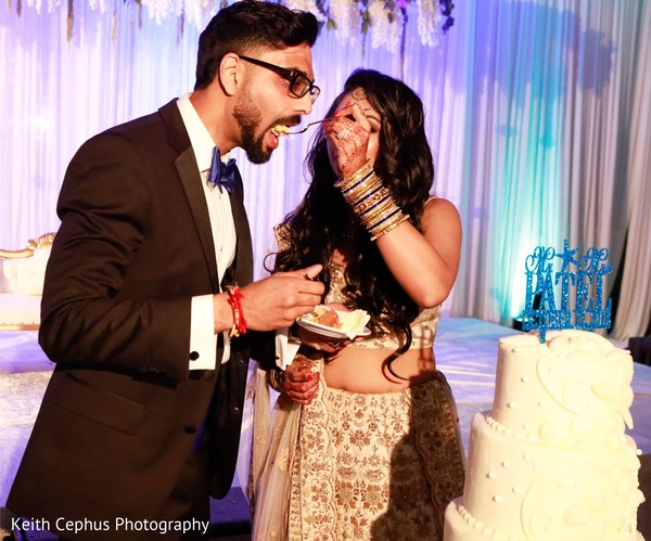 Sweet Indian wedding cake cutting.