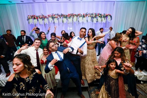 Maharani and rajah dancing at reception.