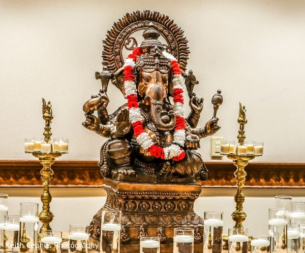 Stunning Indian wedding ceremony god decor.