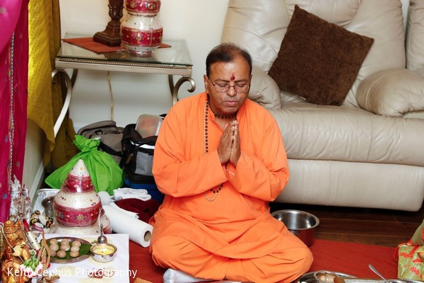 Respectful Indian priest at haldi rituals.