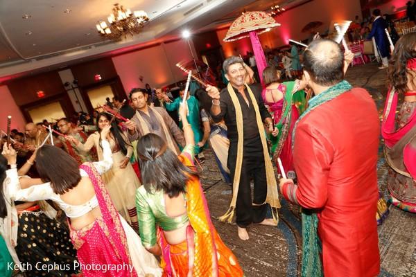Take a look a this traditional garba dandiya dance.