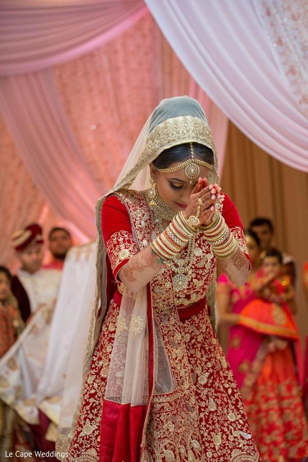 Indian bride having a spiritual moment