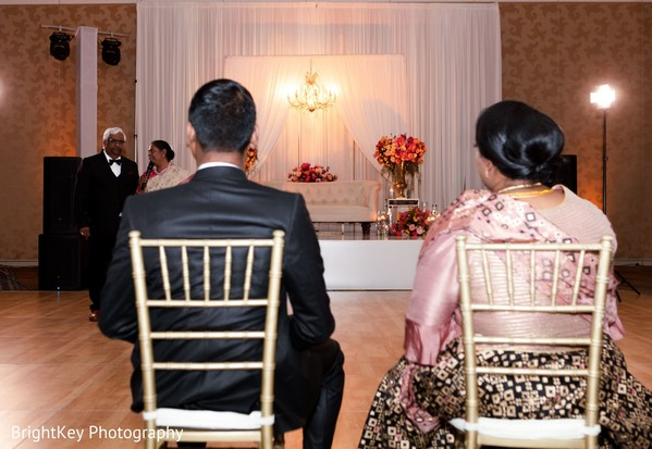 Indian couple during reception speech capture.
