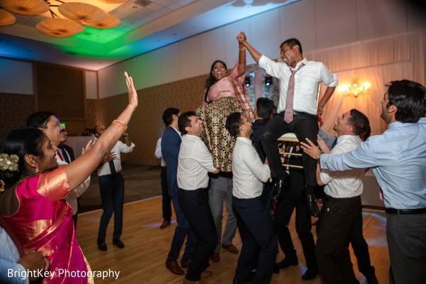 Upbeat Indian couple at reception party.