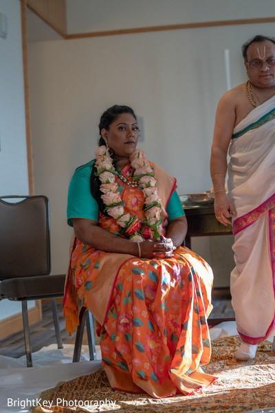 Adorable indian bride at her pre-wedding ritual.