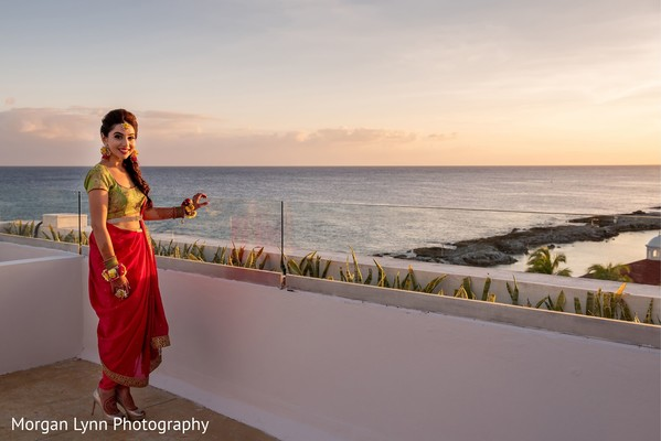 Enchanting Indian bride posing with her sangeet outfit.