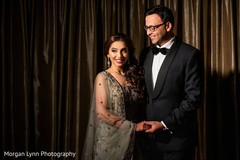 Indian couple posing for reception photo shoot.