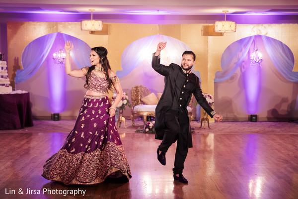 Upbeat Indian lovebirds dance.