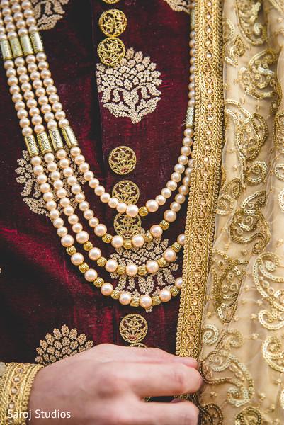 Closeup capture of Indian groom's necklace.