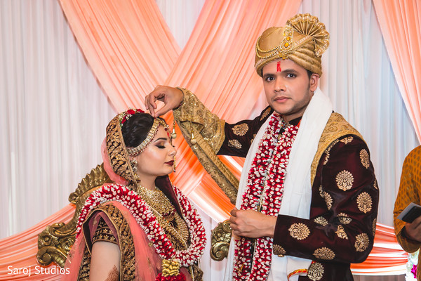 Take a look a this beautiful Indian couple at ceremony ritual.