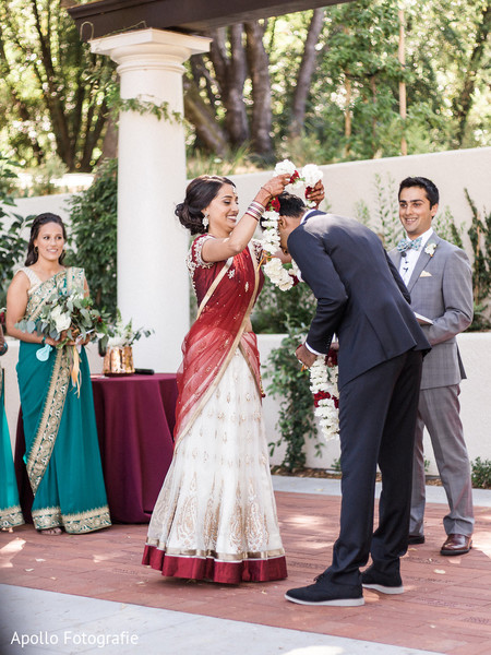 Indian bride putting the garland on the groom