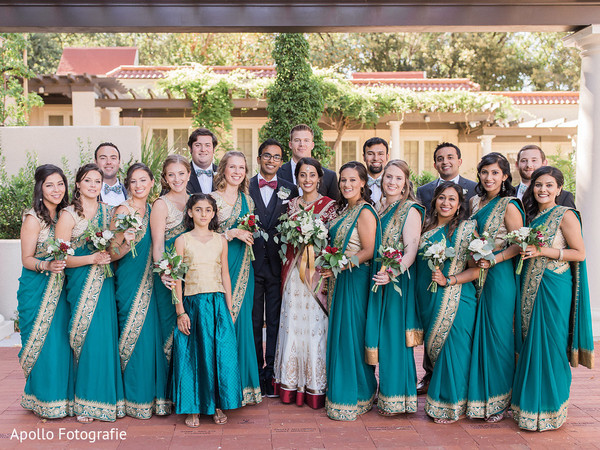 Indian bride and groom posing with special guests