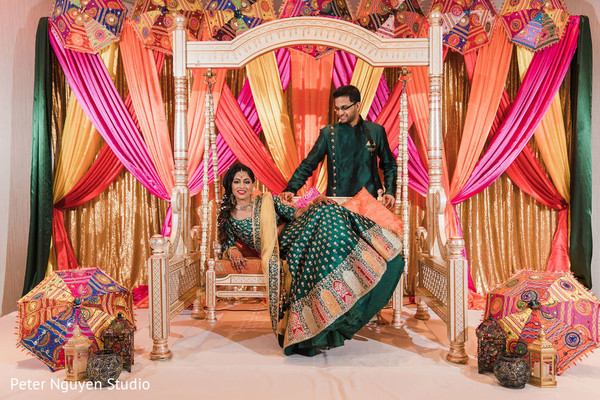 Maharani and Indian groom posing with their attires