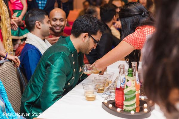 Indian groom having a drink