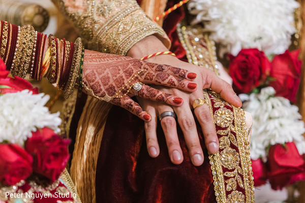 Indian bride showing her mehndi