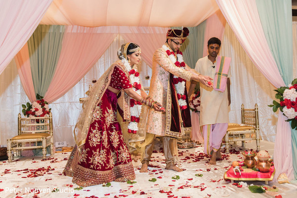 Indian bride and groom performing the rituals